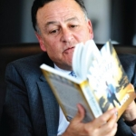 Tony reading Accidental Ambassador