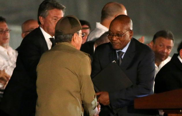 Cuban President Raúl Castro, left, and President Jacob Zuma shake hands at a massive tribute to Cuba's late leader Fidel Castro in Revolution Square, Havana, Cuba. The Cuban trip must have been a relief after Zuma's ordeal at the ANC's NEC. Photograph by: CARLOS GARCIA RAWLINS