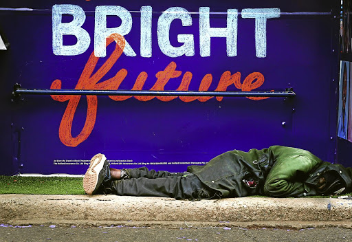 OCTOBER 26, 2017. NOT FOR ARCHIVE OR RESALE. A man sleeps under the shelter of a bus stop , on Oxford Road in Johannesburg, on a gloomy day in the city. PHOTOGRAPH: ALON SKUY/THE TIMES